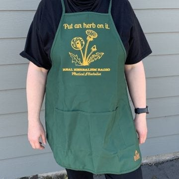 Image apron with Put an Herb On it Slogan